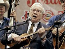 Warren Buffet playing ukulele