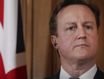 Prime minsiter David Cameron with in ear headphones