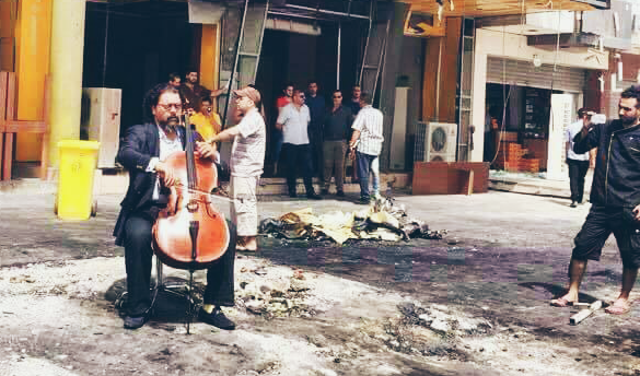 A Man Sits Down To Play Cello In Car Bomb Aftermath